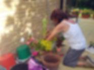 HARP resident planting flowers in pot