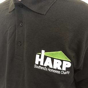HARP Southend's Homeless Charity logo on black staff polo shirt