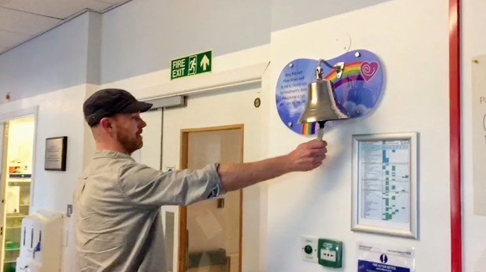 Ringing the bell to signal the end of chemo