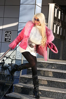 Model Martina Big posing in a pink fur jacket in New York