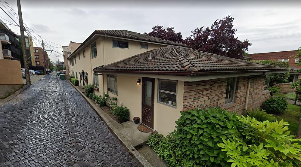 Camellia Manor, 501 E Harrison St. Google 2019. Photoshopped with cobblestone alley.