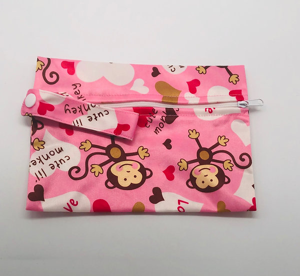 Reusable wet bag for storing clothpads - pink monkey