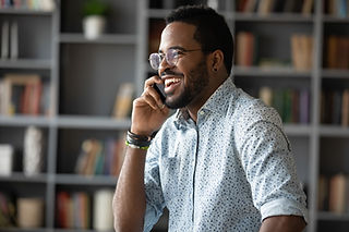 A man talking and laughing on a mobile telephone
