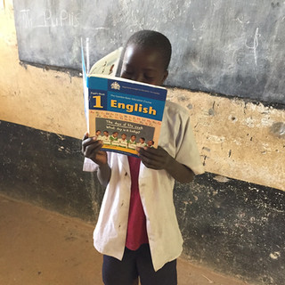 A Gambian student reads