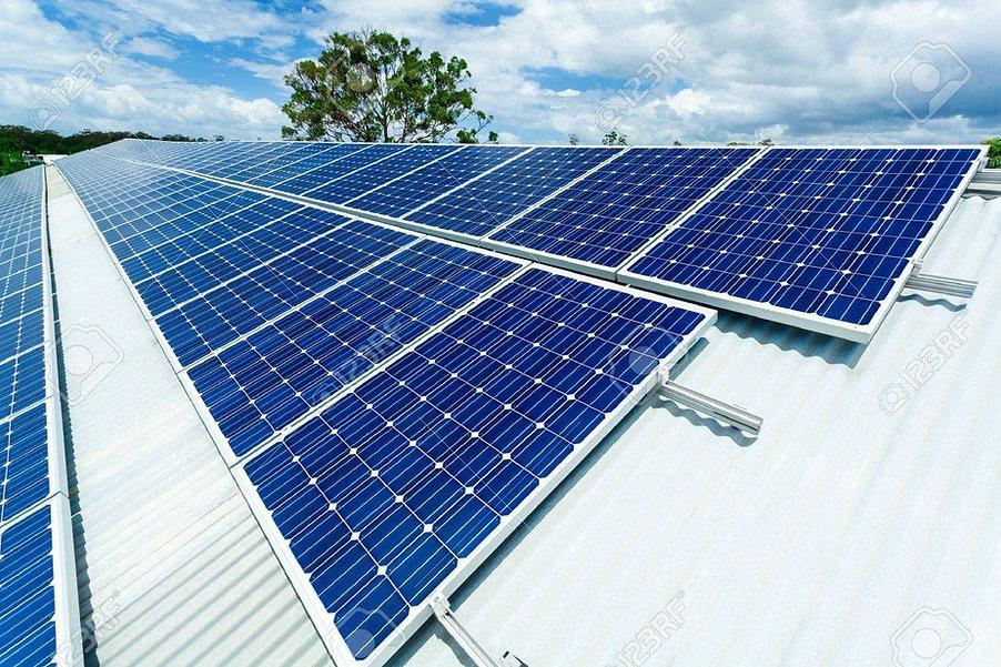 18437261-solar-panels-on-factory-roof.jpg