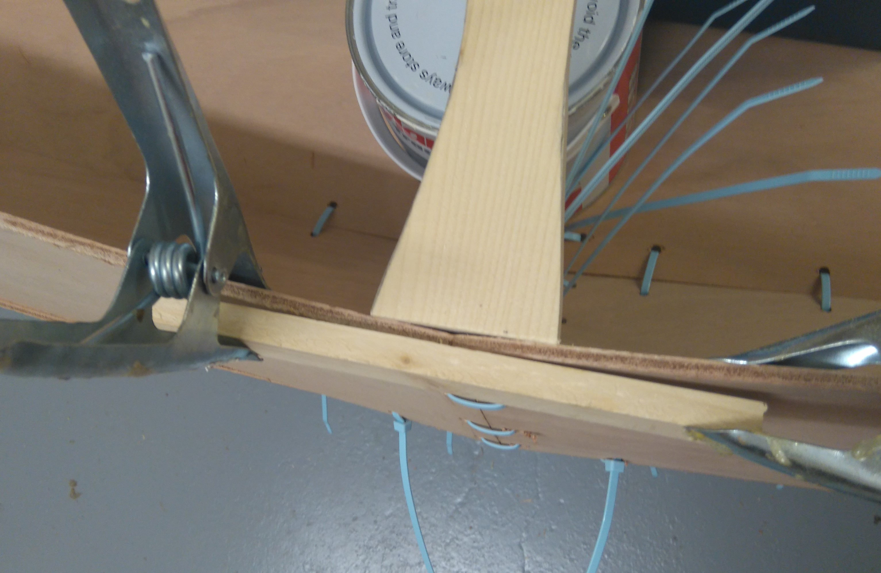 13 Lengths of wood clamped on to keep curve of the canoe fair