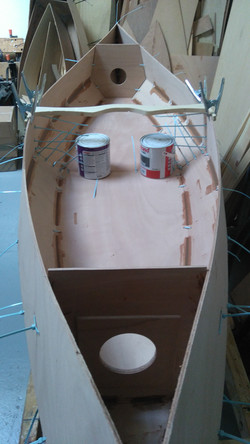 16 Glue fillets applied between the stitches and showing the bulkheads stitched in.