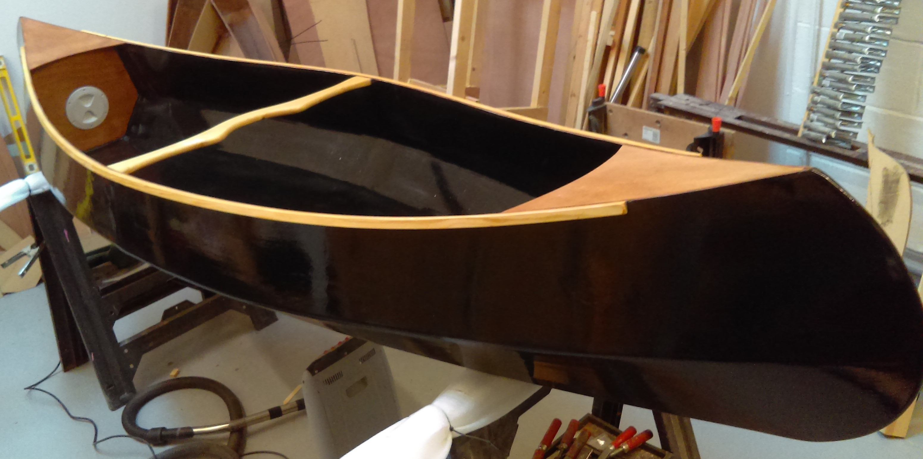 30 The boat is then glossed and varnished to finish