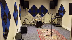 rehearsal room set up with mics