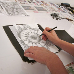 tracing the drawing onto the inked surface