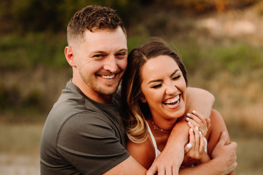 Couple Candily Laughing Engagement Photos