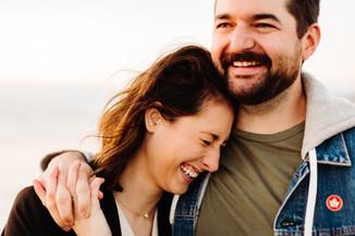 Fun couples photos at sunset at Cannon Beach Oregon