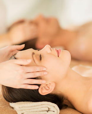 picture of couple in spa salon getting f