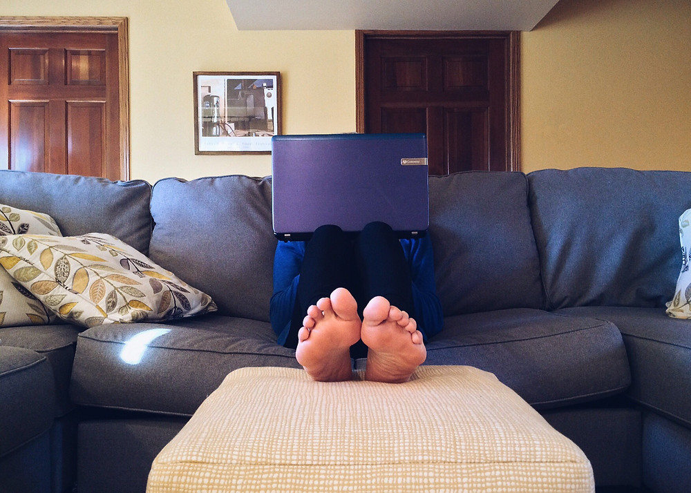 working from home, grey couch,