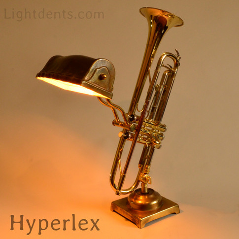 """15"""". Pocket trumpet. On/Off switch in the second valve.$300, 22"""" Trumpet reading lamp. On/Off in the first piston."""