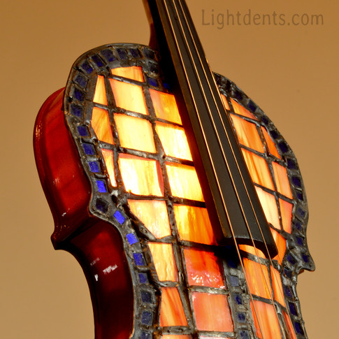 $900.  27_ Violin accent lamp. Light dim