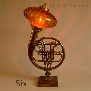 """French Horn. 27"""". On/Off switch in the first valve."""