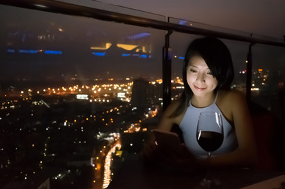 asian lady read message on mobiel at lux