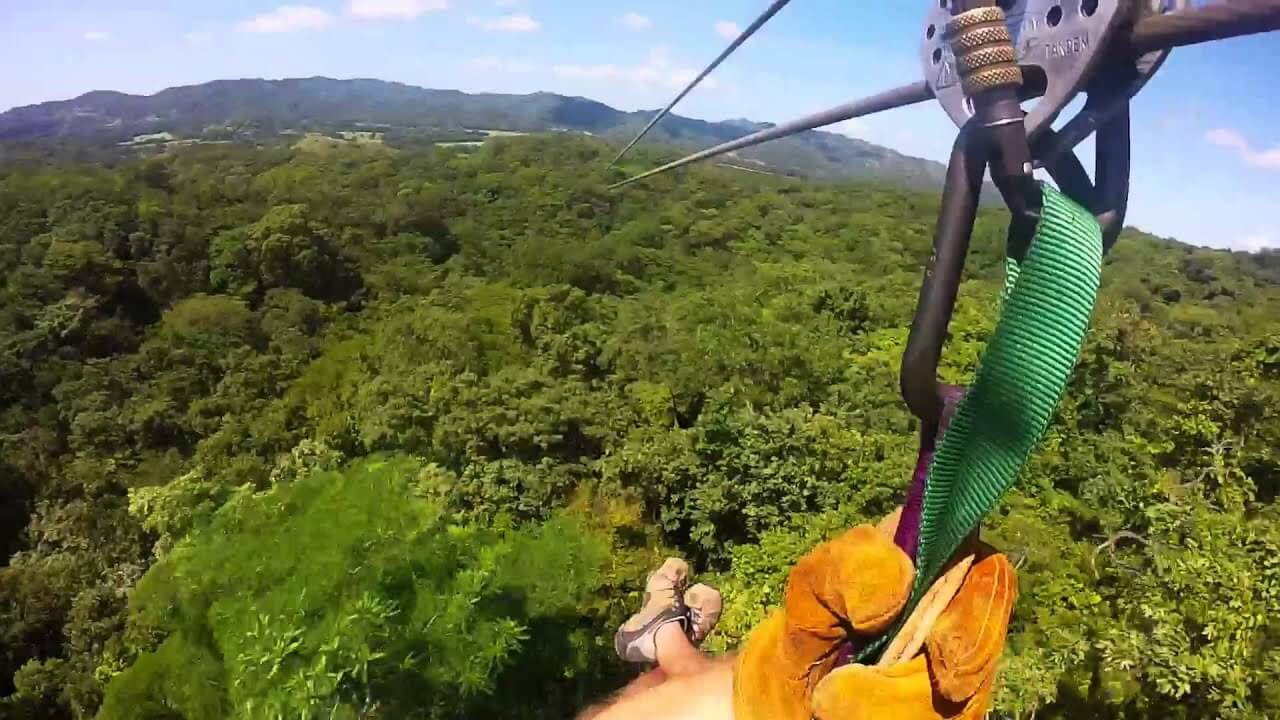 Canopy Ziplining Costa Rica adventure. View of zipline steel cable with lush rainforest nature