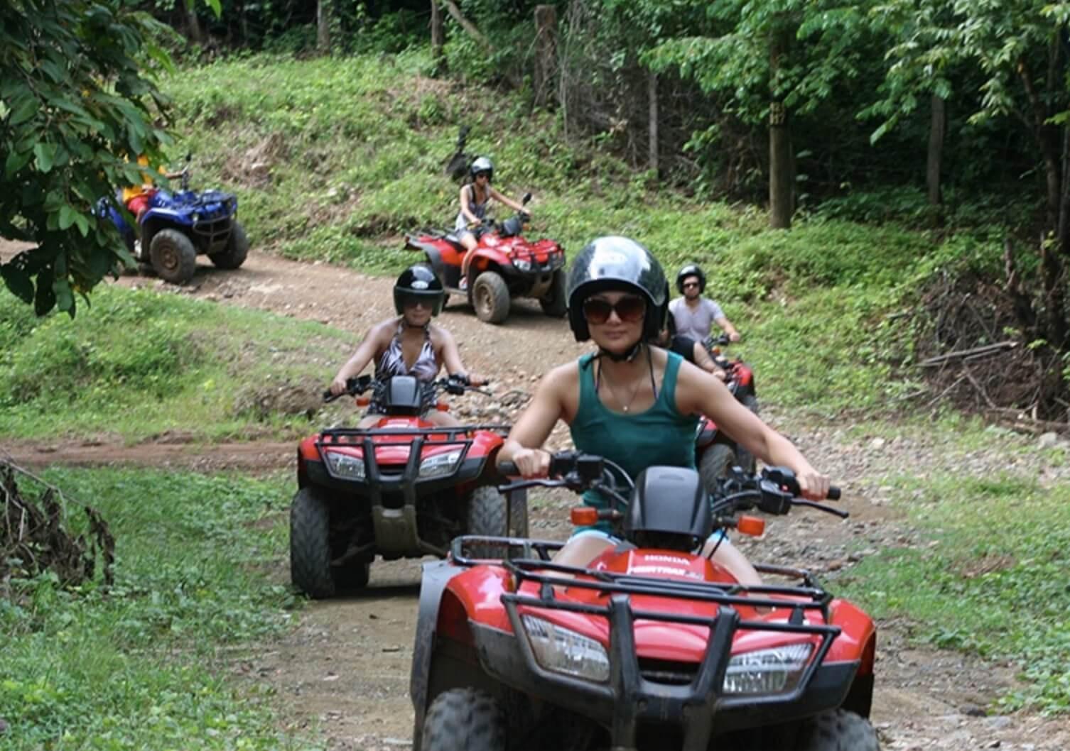 Tamarindo Guanacaste ATV adventure tour group riding along forst trail