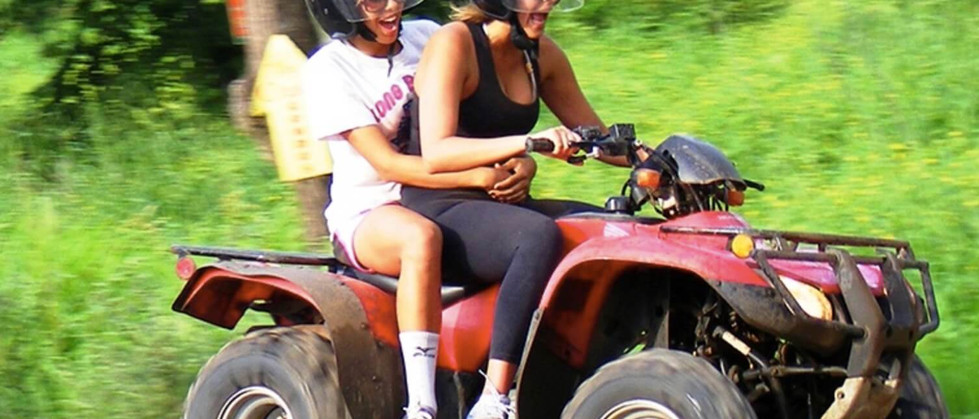 Tamarindo Guanacaste ATV adventure tour rental two women laughing and having fun while riding the ATV