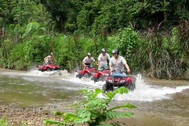 Costa Rica ATV adventure group crossing a river