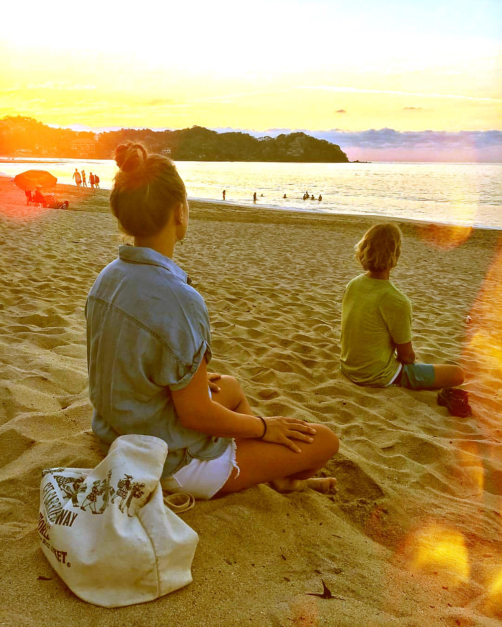 sunset sayulita meditating friends on the beach