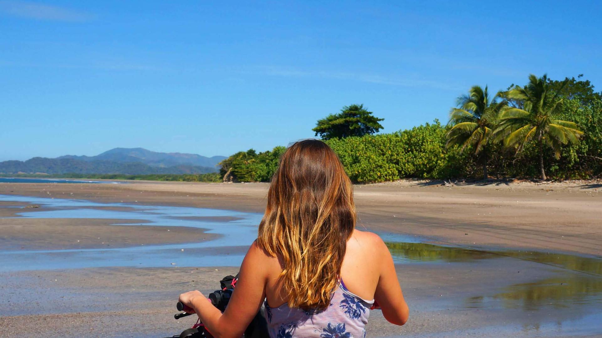 Costa Rica ATV adventure, woman exploring beach