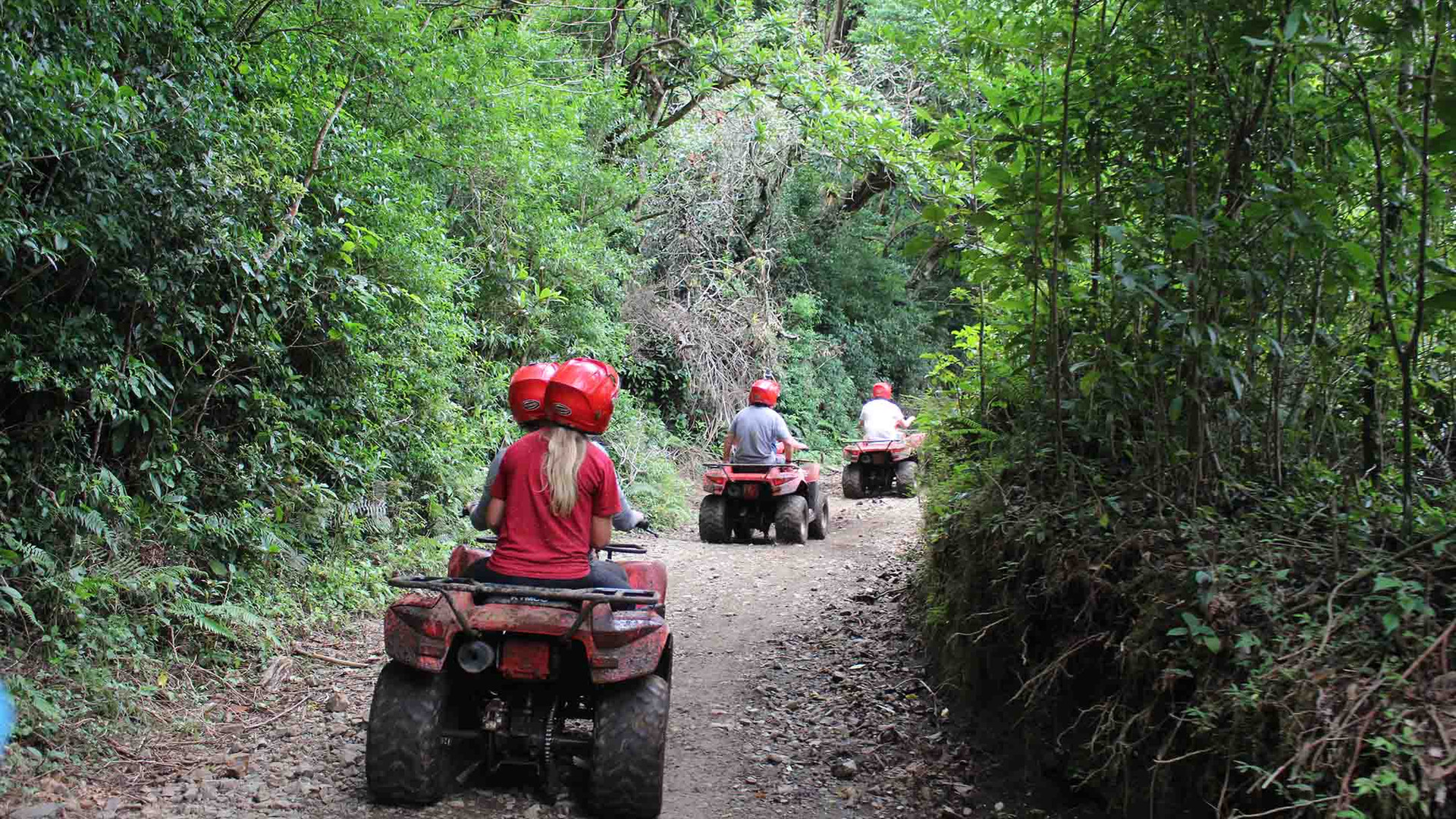Monteverde Costa Rica ATV adventure tour group driving riding on jungle trail