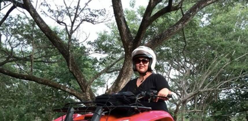 Tamarindo Guanacaste ATV adventure tour guest riding her ATV on a dirt road