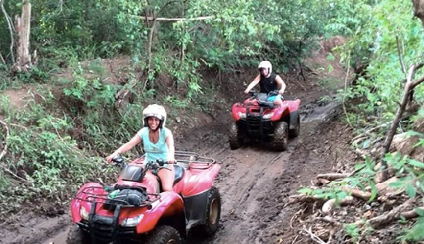 Tamarindo Guanacaste ATV adventure tour group riding driving on dirt forest trail