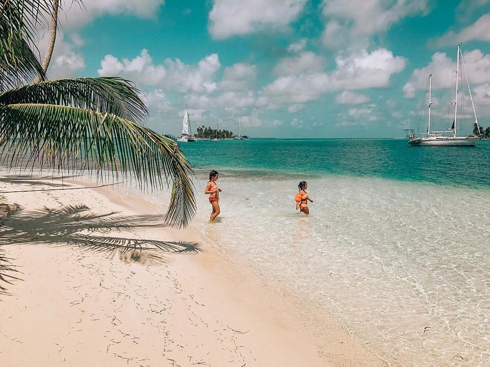 two little girls enjoying the clear ocean waters of San Blas Panama islands