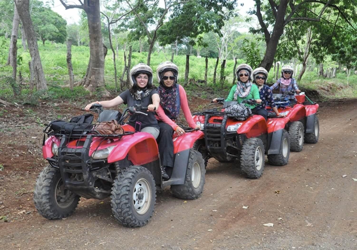 Tamarindo Guanacaste ATV adventure tour group enjoying their experience driving on dirt roads