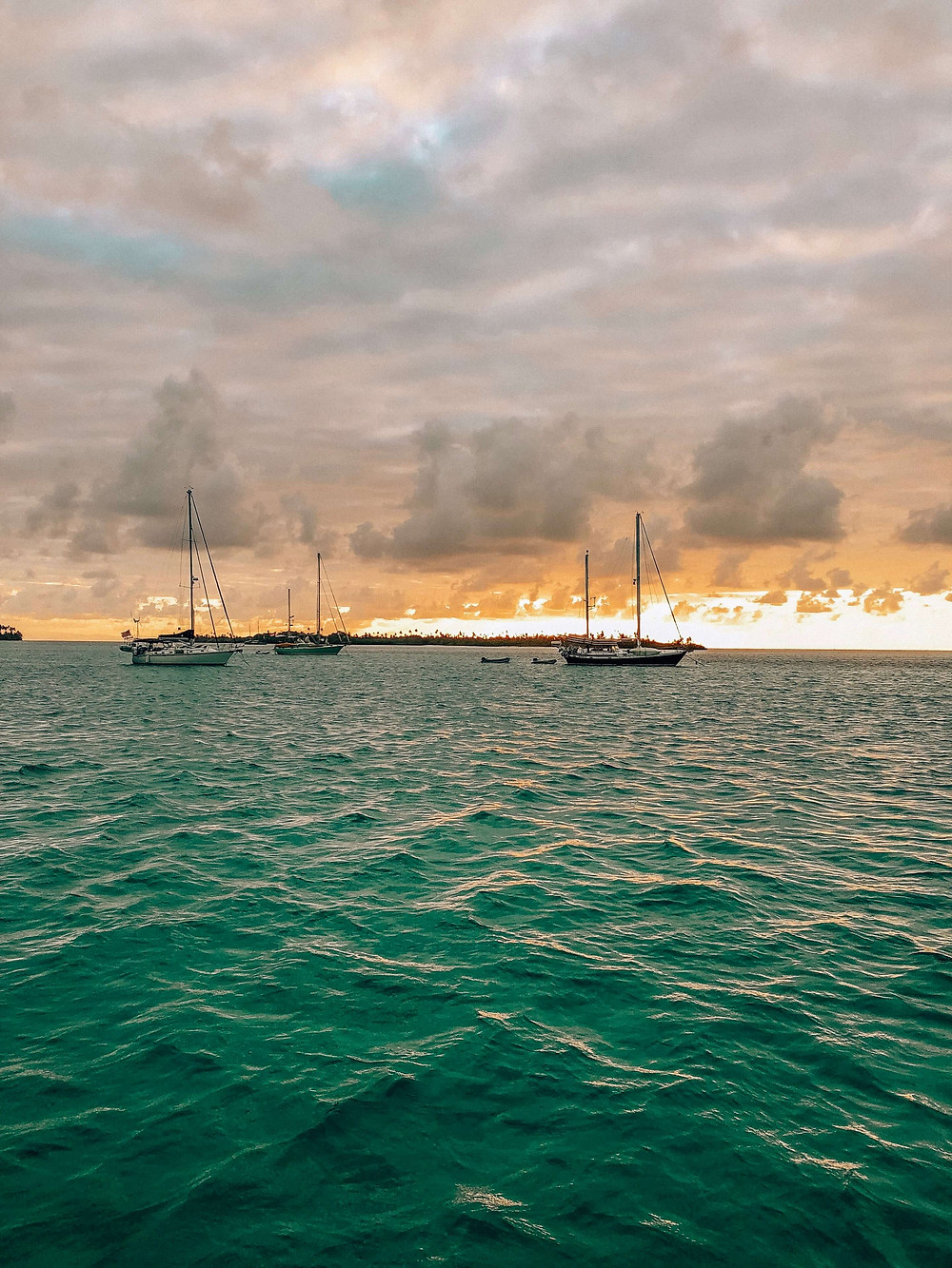 Fiery sunset in San Blas islands of Panama with sailboats