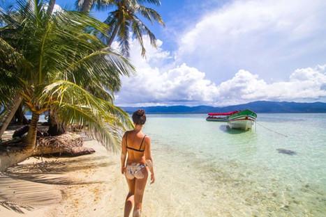 Woman on San Blas beach scene