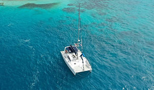 San Blas Sailing Charter catamaran anchored in clear ocean