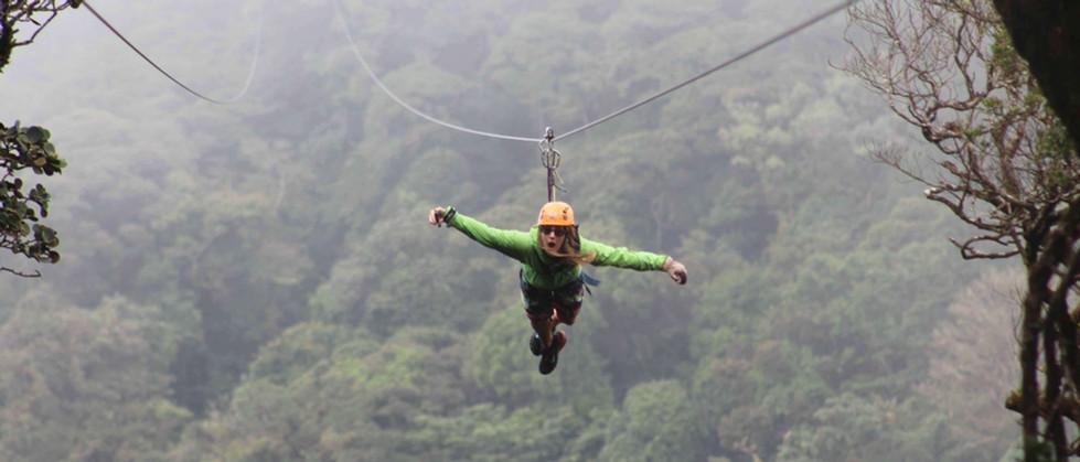 Monteverde Costa Rica zipline adventure guest zipping superman style accross valley