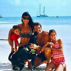 Happy Roca family on beach San Blas