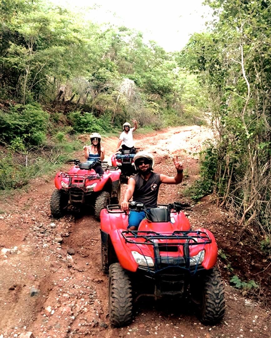 Tamarindo Guanacaste ATV adventure tour group on dirt forest trail