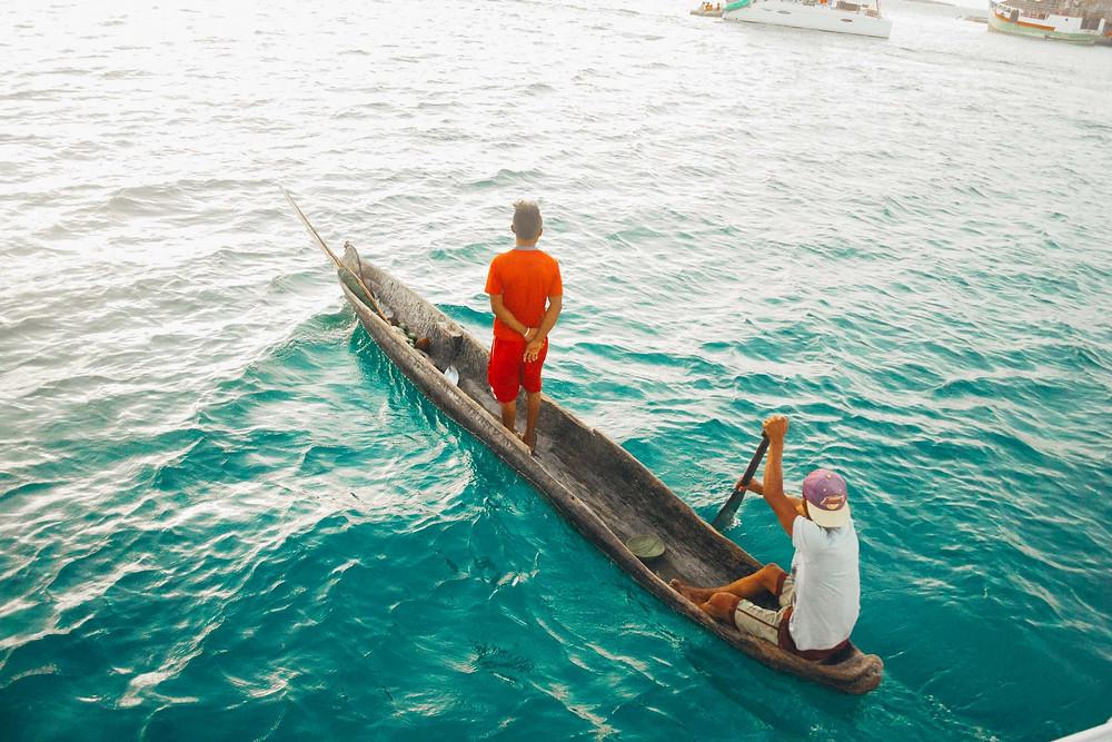 local kuna panga in san blas panama rowing to sailboats