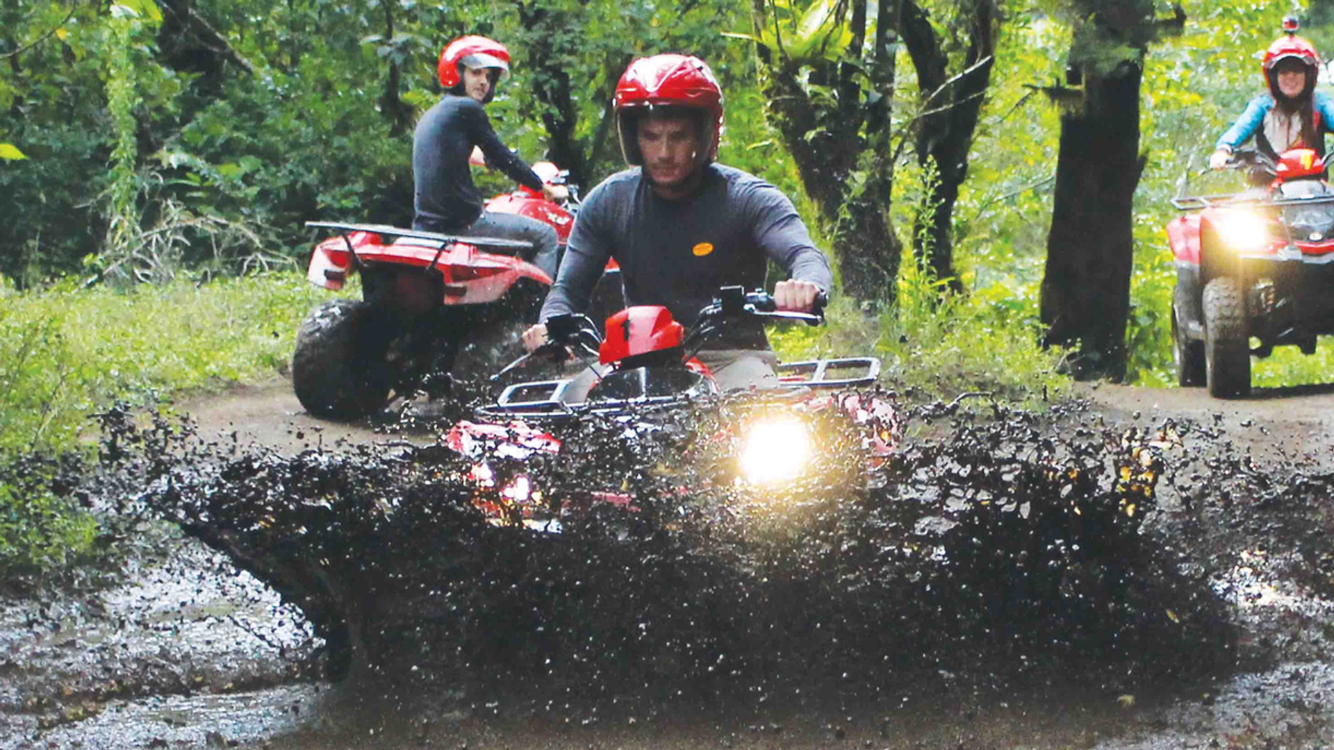 Monteverde Costa Rica ATV adventure tour group driving through mud