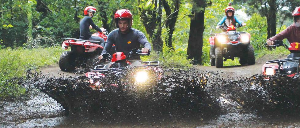 Monteverde Costa Rica ATV adventure tour group driving through mud