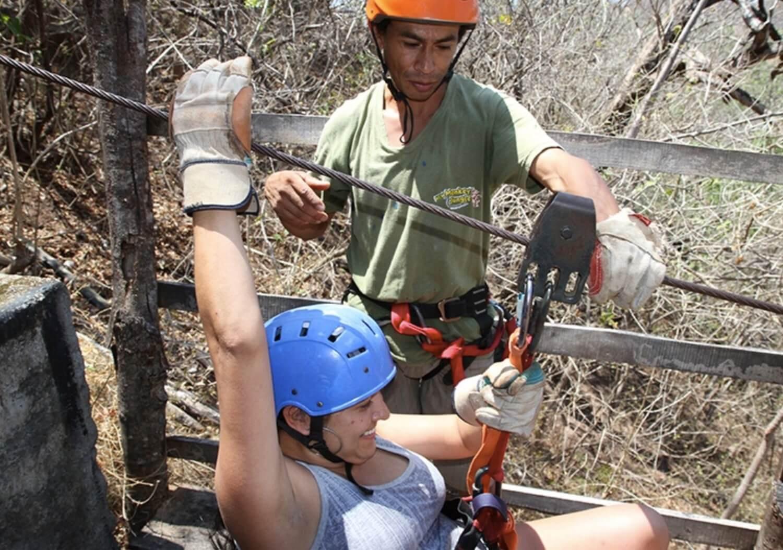 Tamarindo Guanacaste Costa Rica zipline canopy tour guide assisting guest