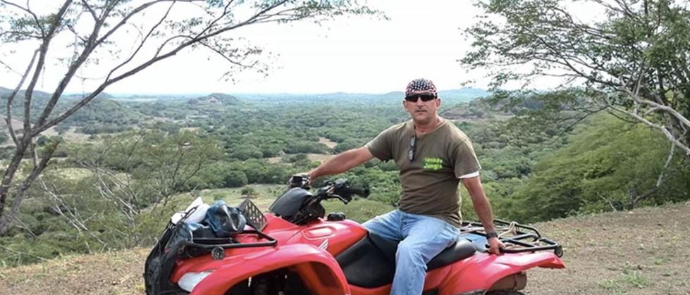 Tamarindo Guanacaste ATV adventure tour guest with beautiful backdrop view