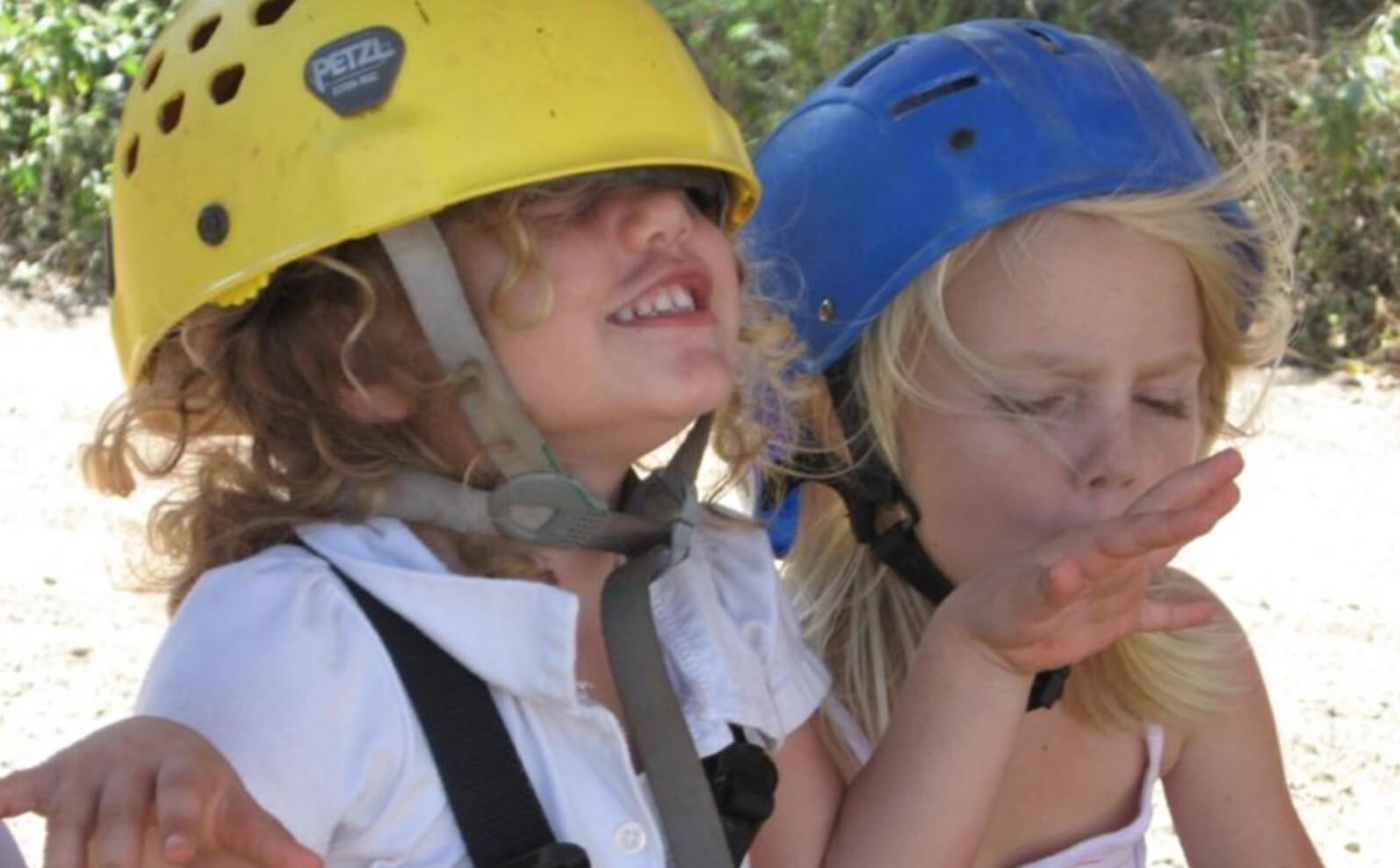 Two cute, blonde kids from canopy zipline group with helmet in Tamarindo Guanacaste Costa Rica
