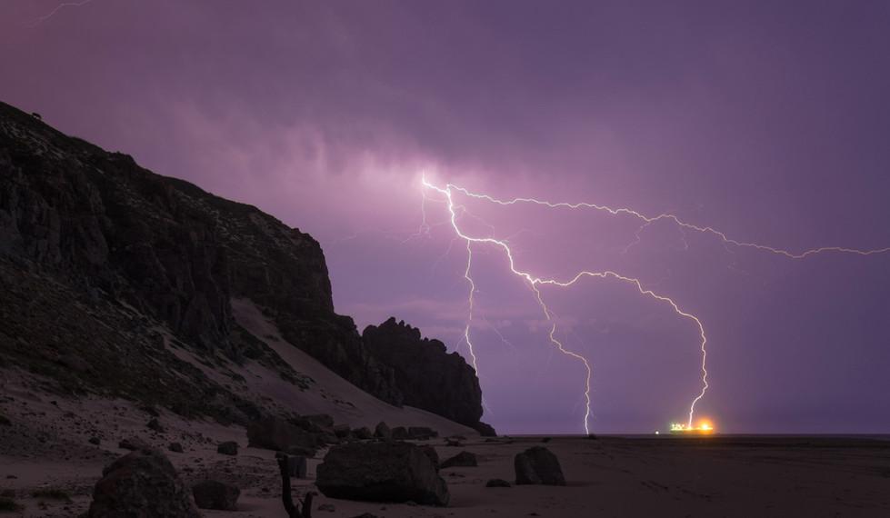 Salina Cruz Surf Camp surf spot at night with lightning striking the ocean