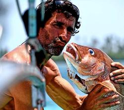 Captain Chris kissing fish San Blas