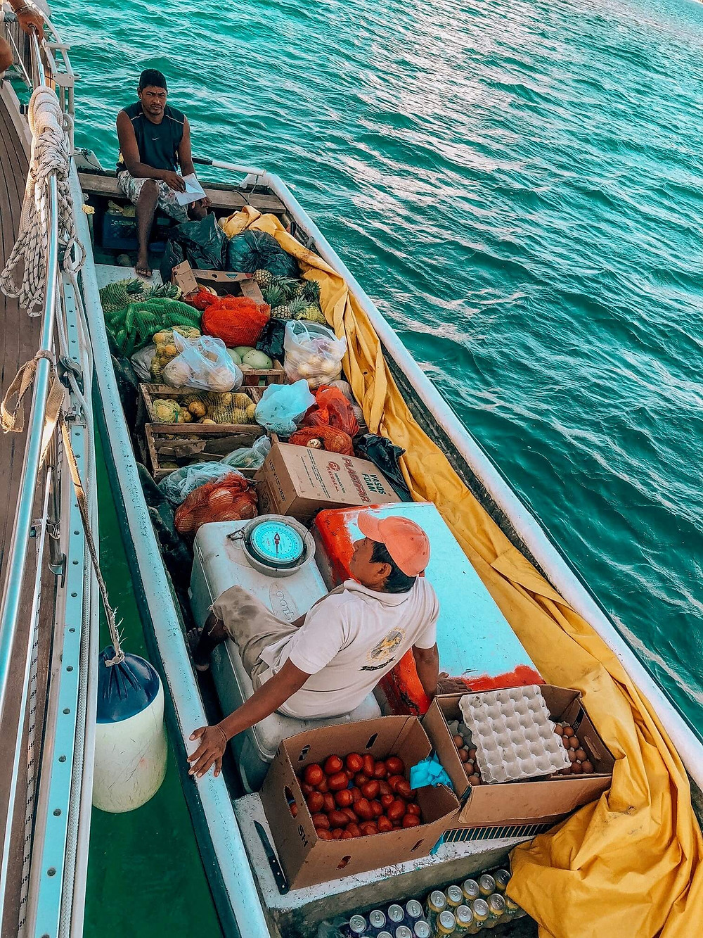 san blas panama kuna boat suplying sailboats with groceries, fresh fruit and vegetables