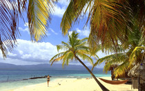 Lonely San Blas beach with woman