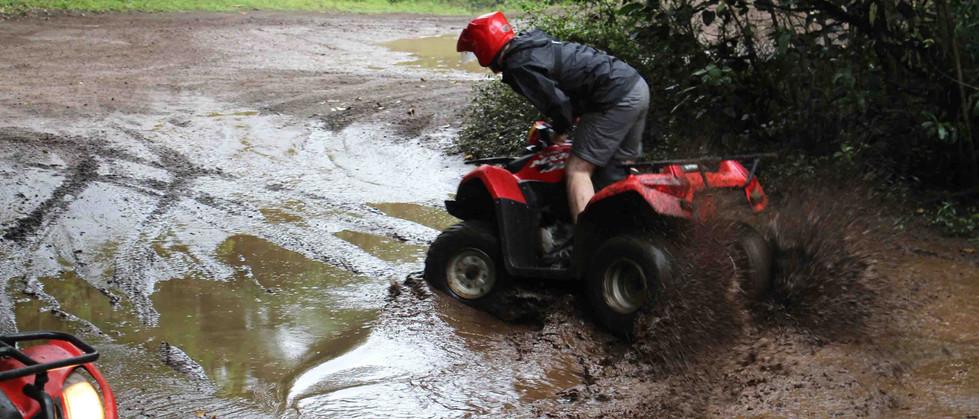 Monteverde Costa Rica ATV adventure tour group driving through mud making sliding donuts